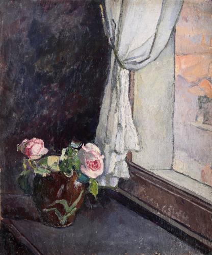Finestra con vaso di rose