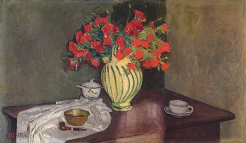 Fiori rossi nel vaso a righe